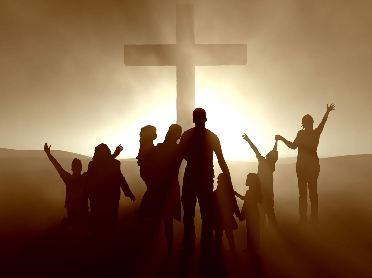 shadowy-images-of-people-gathered-around-the-cross-crop-d0a997-1200x700